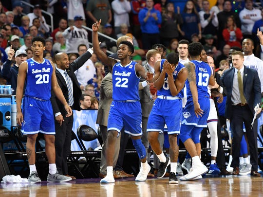 Seton Hall Pirates guard Myles Cale (22) and guard Khadeen Carrington (0) react after a call in the second half in the second round of the 2018 NCAA Tournament against the Kansas Jayhawks