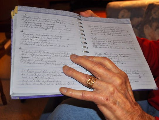 Rudy Ursic holds a notebook that contains many of the
