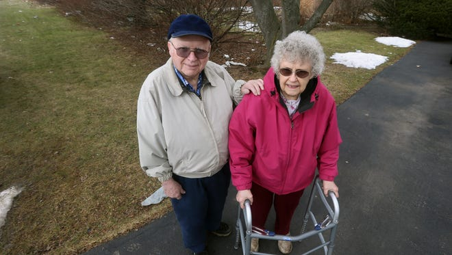 Robert and Ann Dobson have lived in their house on Dobson Road for 50 years. They have been battling mounds of trash that blow into their yard from a nearby plaza.