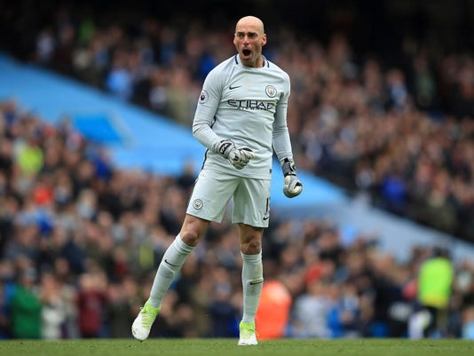 Manchester City goalkeeper Willy Caballero celebrates his side's third goal of the game scored by Kevin De Bruyne during the Premier League soccer match between Manchester City and Crystal Palace at The Etihad Stadium, Manchester, England. Saturday May 6, 2017. (Mike Egerton/PA via AP)