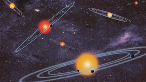NASA released this artist's conception of planets that pass in front of the light from the star they orbit. NASA said it had confirmed 715 planets outside our own solar system.
