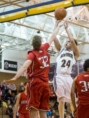 Port Huron Northern senior Geryd Welsh takes a shot in front of Anchor Bay junior Ben Ratkov during a basketball game Thursday, Feb. 11, 2016 at Port Huron Northern High School.