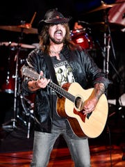 "Billy Ray Cyrus performs ""Achy Breaky Heart"" during"