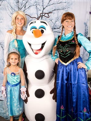 """Kids can get their photos taken with """"Frozen"""" characters at Snow Day 2016."""