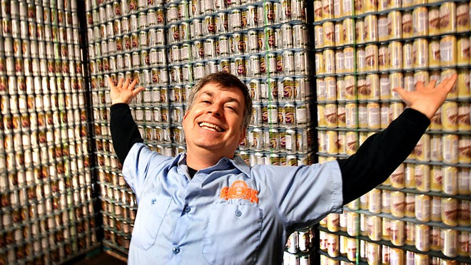 A brave and happy pioneer, Dave Colt (above) is an owner and brewer at Sun King Brewery, 135 N. College Ave. The microbrewery cans (left) and distributes its tasty suds.