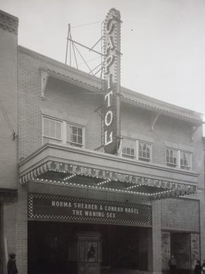 "A historic photograph of the Capitol taken on or around February 3, 1927, which was the theater's opening night. The marquee displays the name of the first film shown at the Capitol - ""The Waning Sex,"" a comedy starring Norma Shearer and Conrad Nagel."