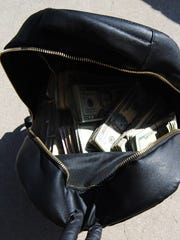 The South Texas Specialized Crimes and Narcotics Task Force seized shopping bags, backpacks and duffle bags filled with $427,481 total in cash on April 10, 2018.