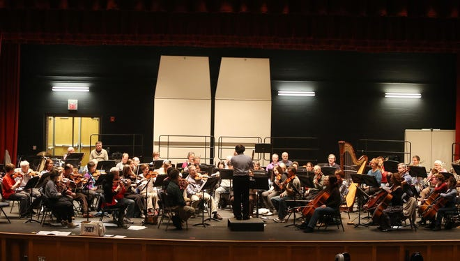 The Newark Symphony Orchestra rehearses for its upcoming Sunday concert.