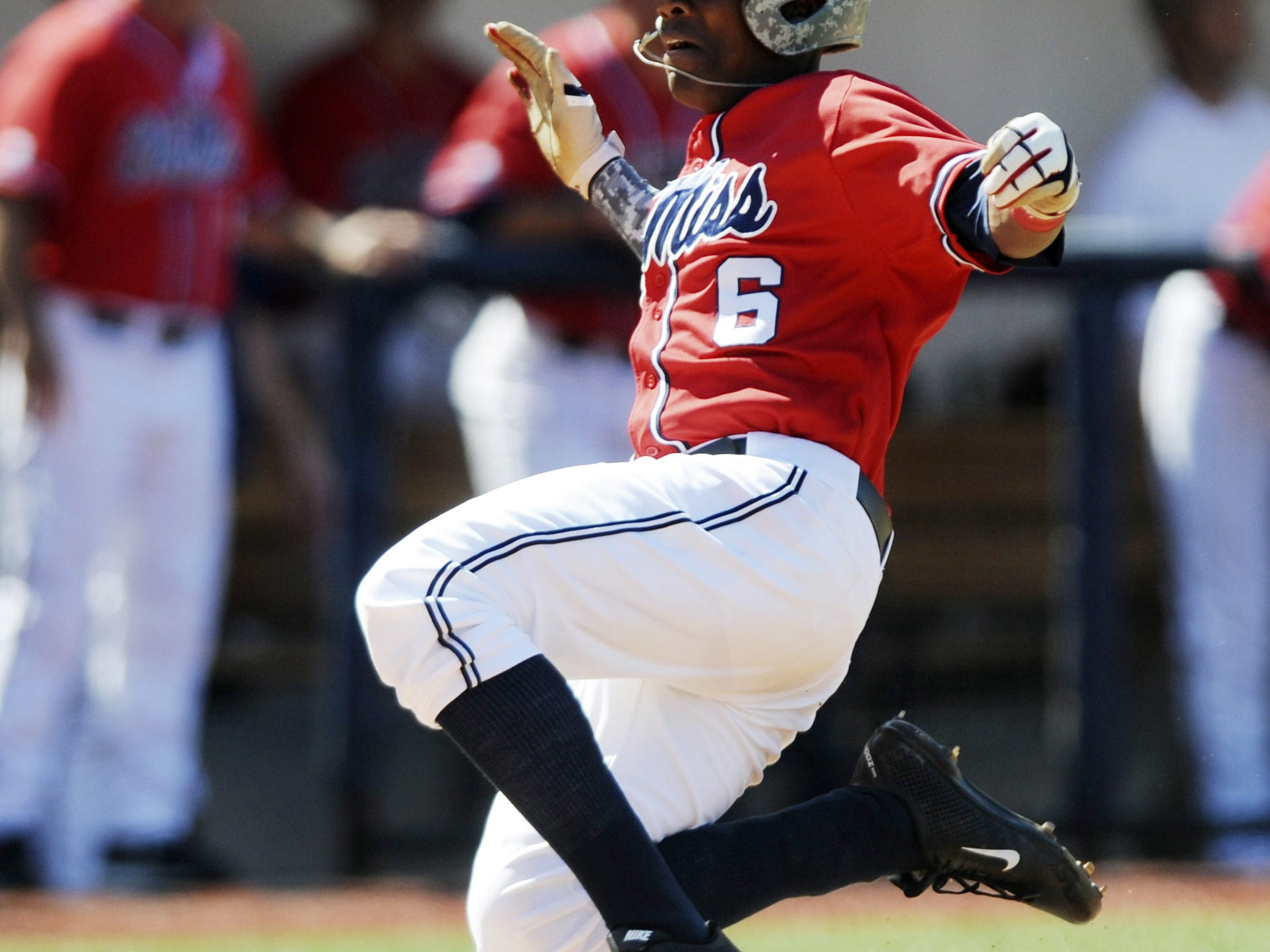 Ole Miss? Errol Robinson scores against Arkansas on Saturday in Oxford. Bruce Newman/Oxford Eagle Mississippi's Errol Robinson (6) scores against Arkansas in an NCAA college baseball game at Oxford-University Stadium in Oxford, Miss., on Saturday, May 3, 2014. (AP Photo/Oxford Eagle, Bruce Newman) MAGS OUT, NO SALES, MANDATORY CREDIT