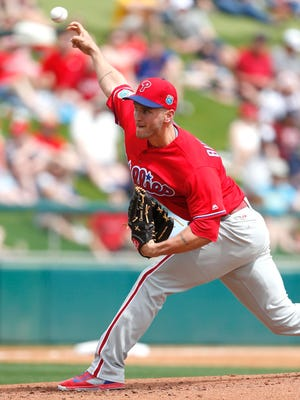 Phillies starting pitcher David Buchanan throws against the Atlanta Braves during the first inning Friday at Champion Stadium.