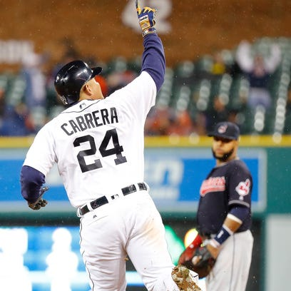 Tigers' Miguel Cabrera rounds first base after hitting