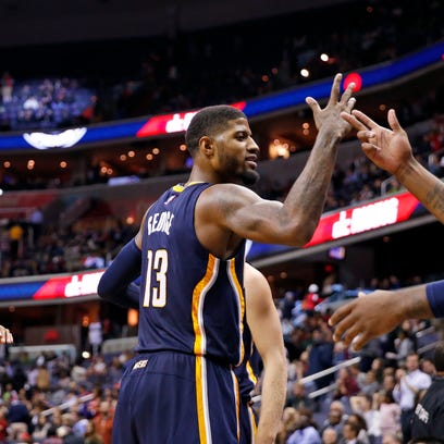 Indiana Pacers forward Paul George (13) and Indiana