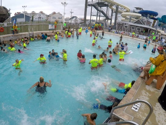 People take part in the World's Largest Swimming Lesson