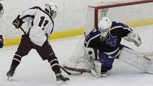 Scarsdale's Ryan Collins shoots on New Rochelle goalie Alex Herman during their hockey Section 1 Division I playoff game at the Ice Hutch Feb. 16, 2018. Scarsdale won 5-2.
