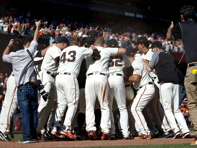 Oct. 1: Giants players celebrate after defeating the
