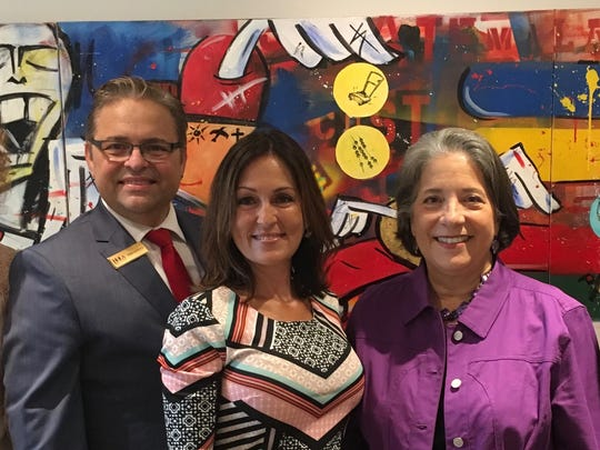 "At the kickoff breakfast for Hispanic Heritage Month hosted by HoLa Hora Latina are Angela Masini, Pedro Tomás, Patricia Robledo, Mayor Madeline Rogero and Marco Villareal. In the background is a painting in three panels by Antuco Chicaíza titled ""Not Just Tacos."""