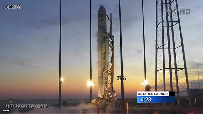 The Cygnus rocket sits on the launch pad less than five minutes before the planned launch of the rocket from the NASA Wallops Flight Facility in Wallops Island, Va., on Oct. 28.