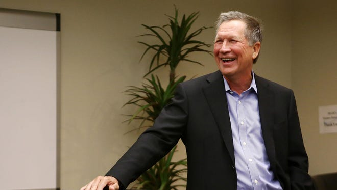 John Kasich often speaks off the cuff, complete with jokes that sometimes border on corny. Here, Kasich laughs during a campaign stop last month in Lansing.