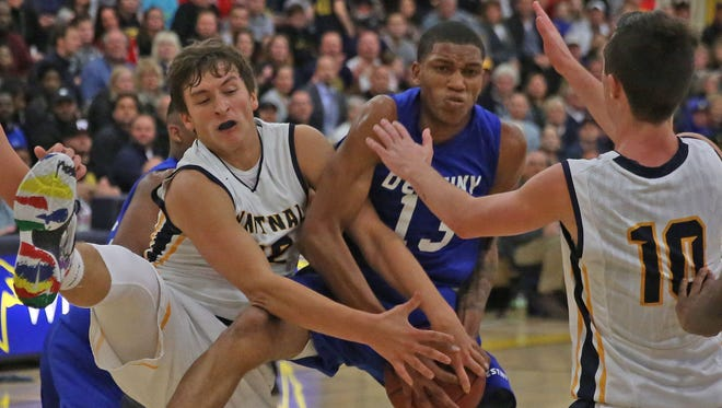 Destiny's Zachary Markland fights for a rebound against Whitnall in a game earlier this season. Destiny is 19-1 with one game left in the regular season.