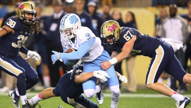 North Carolina receiver Ryan Switzer fights for extra yards on a punt return against Pittsburgh.