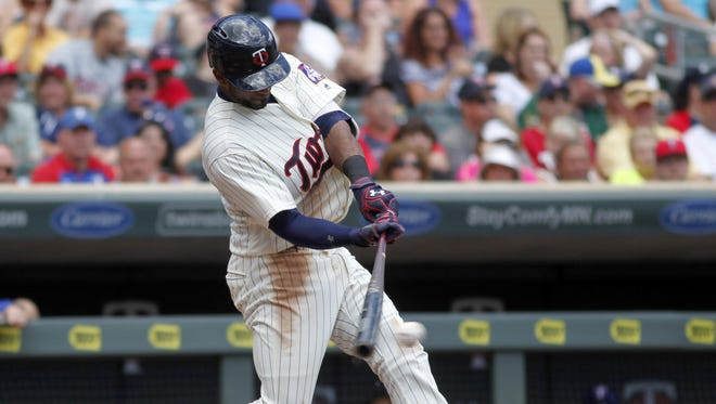 Minnesota Twins Eduardo Nunez hits an RBI-single in the fifth inning against the Texas Rangers on Saturday, July 2, 2016 in Minneapolis.
