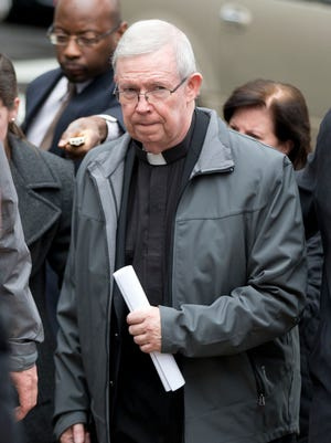Monsignor William Lynn walks from the criminal justice center after a bail hearing, Monday, Jan. 6, 2014, in Philadelphia.