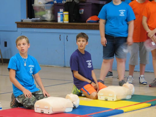 Campers practice CPR techniques at Camp R & R in Grand Isle County.