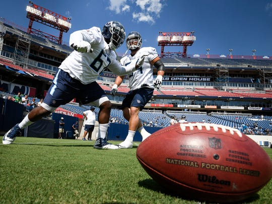 Titans guard Quinton Spain (67) and guard Josh Kline (64) warm up during a training camp practice at Nissan Stadium Saturday, Aug. 4, 2018, in Nashville, Tenn.