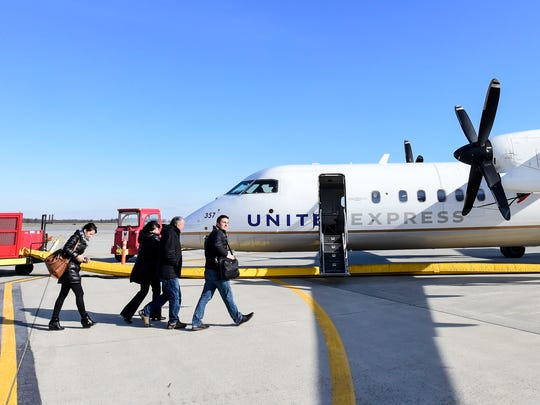 Passengers board a United Airlines plane on Wednesday,