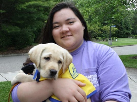 Caroline Hu recently began raising an assistance dog in-training for Canine Companions for Independence, a national nonprofit organization providing trained assistance dogs for children and adults with disabilities.