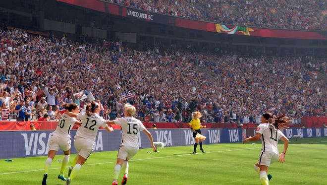 In 2015, United States midfielder Carli Lloyd (10) celebrated her second of three goals against Japan with United States midfielder Lauren Holiday (12) and United States midfielder Megan Rapinoe (15) during the final of the 2015 Women's World Cup at BC Place Stadium. The United States won 5-2. Mandatory Credit: Anne-Marie Sorvin-United States TODAY Sports