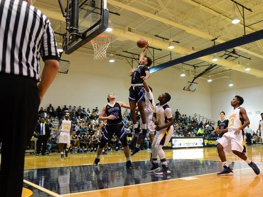Decatur's Kevon Voyles with the reverse layup against Pocomoke High School on Monday, Dec. 12, 2017 in Pocomoke City, Md.