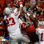 Ohio State safety Tyvis Powell (23) intercepts a pass intended for Alabama wide receiver DeAndrew White (2) to secure the win in the Sugar Bowl late Thursday night.