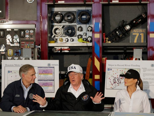 President Donald Trump, flanked by Texas Gov. Greg