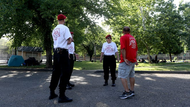 Members of the Redding Guardian Angels talk Thursday where they patrol at South City Park.