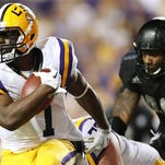 LSU running back Leonard Fournette (7) runs with the ball during the first half an NCAA college football game against Texas A&M.