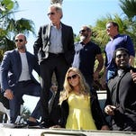From left, Dolph Lundgren, Jason Statham, Harrison Ford, Mel Gibson, Sylvester Stallone, Wesley Snipes and Ronda Rousey during a photo call for The Expendables 3 at the 67th international film festival at Cannes.