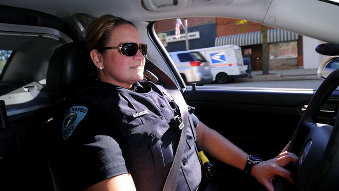 Eaton Rapids Police Officer Lisa Kirby in a patrol car in 2014.