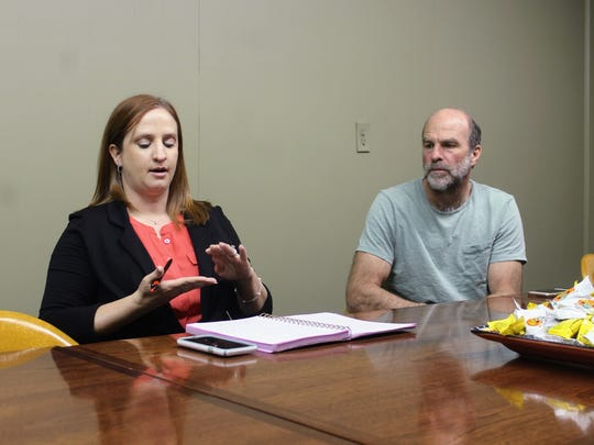 TerranearPMC Public Outreach Liaison Katie Roberts and Program Manager and Senior Geologist Peter Gram discuss the Salt Basin Deep Borehole Research Project at the Daily News office Thursday.