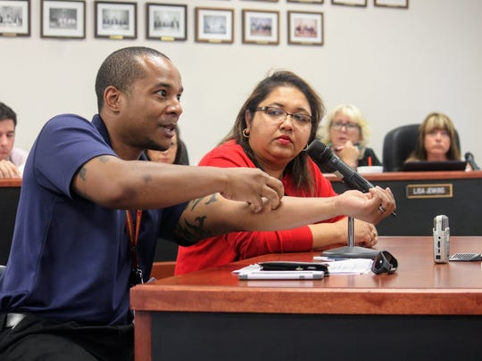 New Mexico Department of Health Emergency Preparedness Specialist David Daniels demonstrates how a Zika virus mosquito bites and spreads the disease as DOH's Zika Outreach Coordinator Syeda Nargis observes at the Otero County regular commission meeting Thursday, July 13.