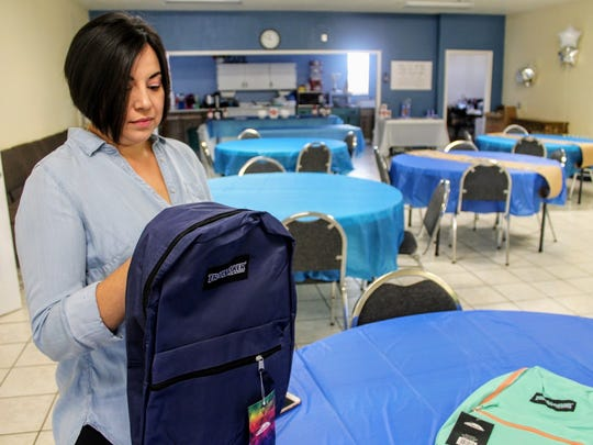 Sasha Torres holds a backpack that she and her husband are giving away during their first annual back to school backpack drive Saturday, Aug. 12, from 11 a.m. to 2 p.m. at Mountain View Assembly of God.
