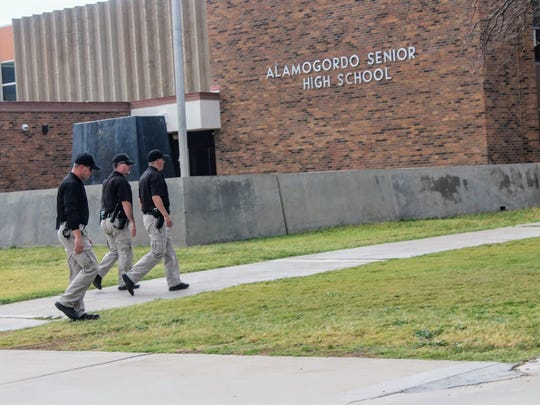 Alamogordo Police Department officers are seen walking towards Alamogordo High School Thursday, Oct. 5 as they investigate a suspect who was seen brandishing a gun in the school's parking lot.