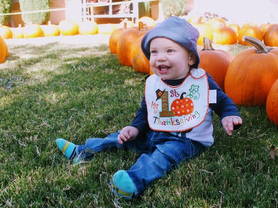 Joseph Fitzpatrick enjoys his first time at the Grace United Methodist Church pumpkin patch Monday afternoon.