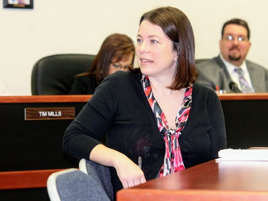 Dara Parker, Las Cruces Field Representative for Sen. Martin Heinrich, discusses the benefits of establishing White Sands National Monument as a national park at Thursday's Otero County Commission meeting.