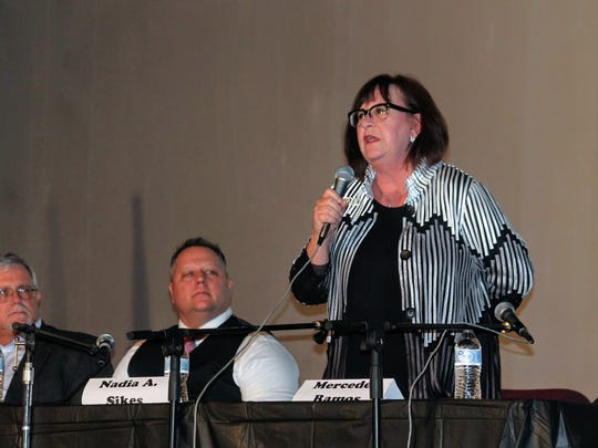 Incumbent City Commissioner Nadia Sikes introduces herself at Tuesday's City Commission candidate debate.
