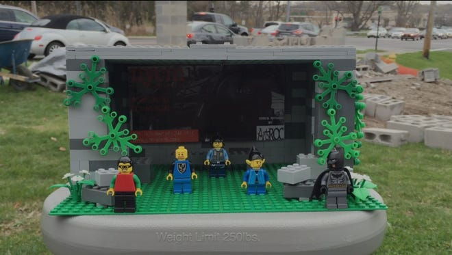 A lego-themed bus shelter model.