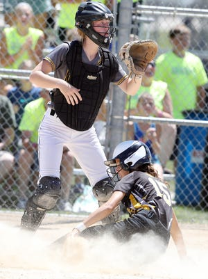 New London High School catcher Layney Loyd waits for the throw as Pyper McCarville scores during their Class 1A state consolation game against Janesville High School July 17, 2018 at Harlan Rogers Park in Fort Dodge.