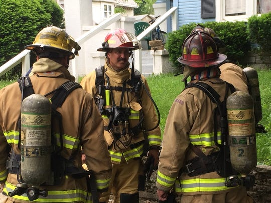 Lt. Chris Allen talks to other Richmond Fire Department firefighters at a home with an electrical problem Thursday. Allen previously served in the Army during Operation Desert Storm.