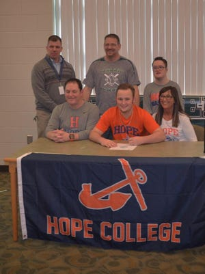 Pennfield senior Max Jackson (center) signs a Letter  of Intent to play baseball at Hope College. He is surrounded by his parents, Gordy and Deb Jackson, Pennfield Athletic Director Brett Steele, Pennfield baseball coach Rob Moran and brother Max Jackson.