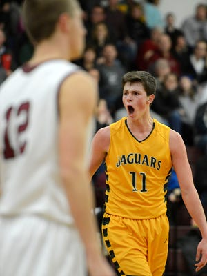 Ashwaubenon's Kyle Monroe (11) screams with emotion after hitting a three-pointer and getting fouled during Tuesday night's boys basketball game against De Pere at De Pere High School. Evan Siegle/Press-Gazette Media